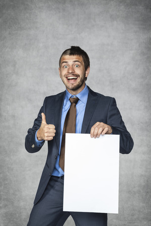 businessman with a funny haircut holding a card with copy space photo