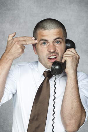 to commit: employee hotline ready to commit suicide Stock Photo