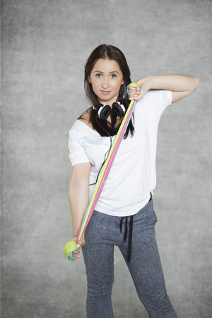 sport clothes: woman in sport clothes performing an exercise