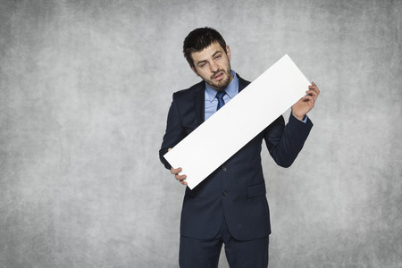 ad: disappointed businessman holds an ad