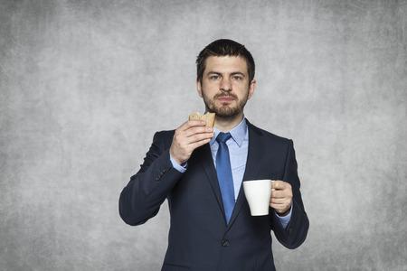 사업가와 그의 샌드위치 스톡 콘텐츠