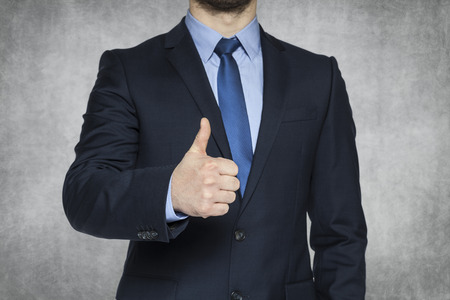 lifted: businessman with thumb lifted upwards Stock Photo
