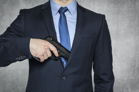 body guard: businessman with a gun