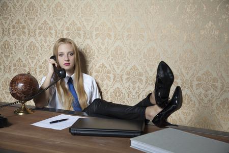 feet on desk: secretary with her feet on the desk