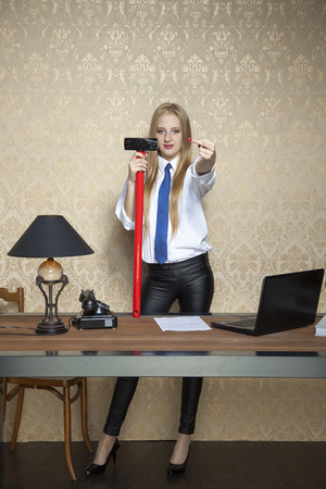 freaked: business woman with a big hammer shows the ugly gesture