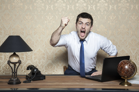 very angry businessman screaming Stock Photo