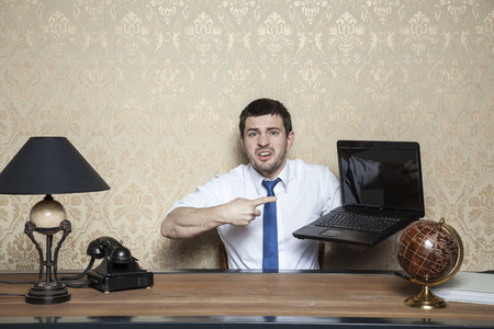 awkwardness: laptop stopped working again Stock Photo