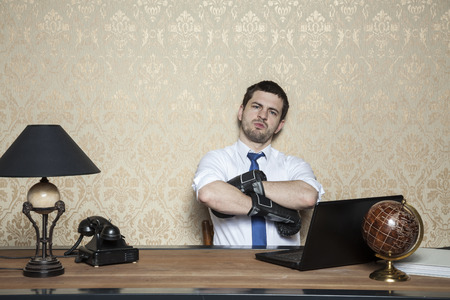 businessman in boxing gloves sitting in office