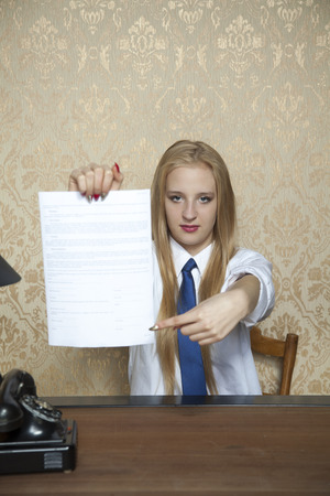 municipal utilities: business woman showing where to sign a contract Stock Photo