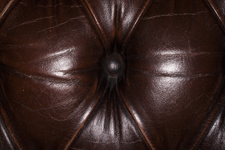 chambered: button on the leather sofa