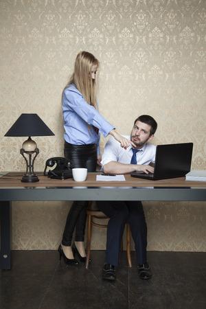 overtime: boss makes work overtime Stock Photo