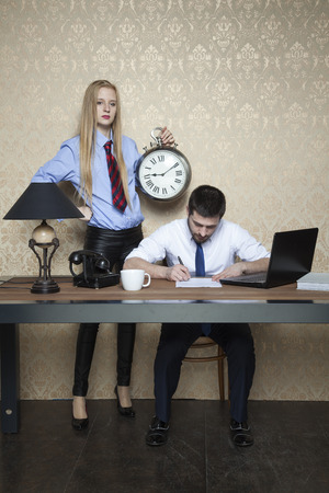censure: businessman working hard time chasing Stock Photo