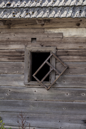 shackled: old dilapidated window
