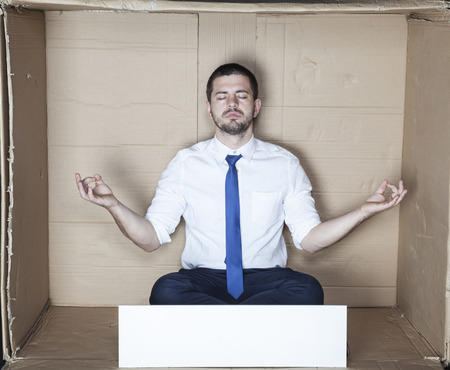 destress: businessman meditating Stock Photo