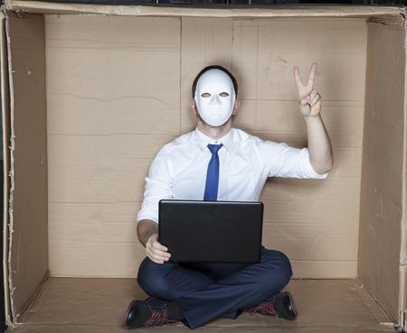 careerist: hacker executes a sign of peace Stock Photo