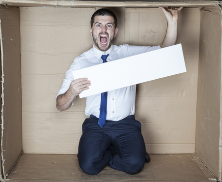 cramped space: employee ads Stock Photo