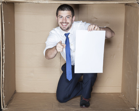 minimization: business man with paper pointing at you