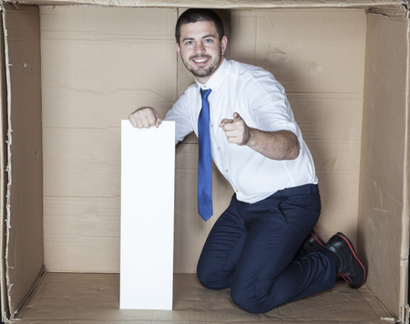 cramped: businessman in the small office pointing Stock Photo