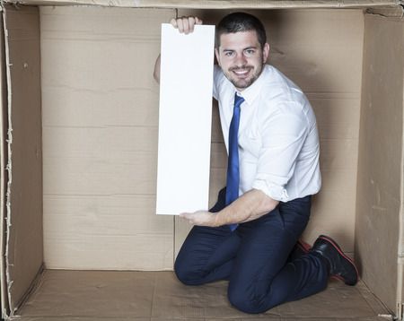 cramped space: smille and happy businessman Stock Photo
