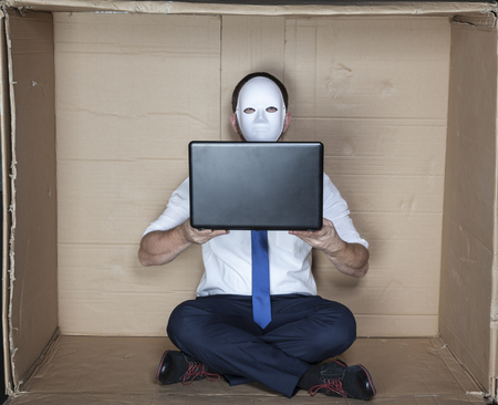 tight focus: hacker holds a computer Stock Photo