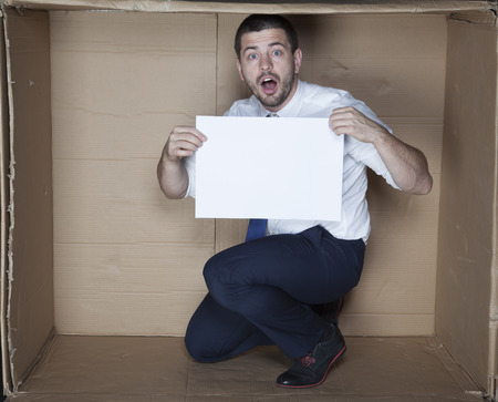 careerist: surprised businessman holding a piece of paper Stock Photo