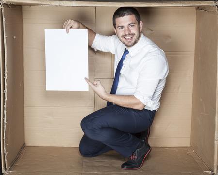 minimization: businessman pointing sheet of paper