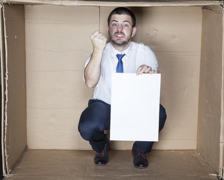 careerist: businessman threatens fist