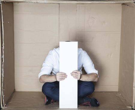 cramped space: businessman hides its head