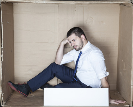 cramped space: businessman depressed after losing job
