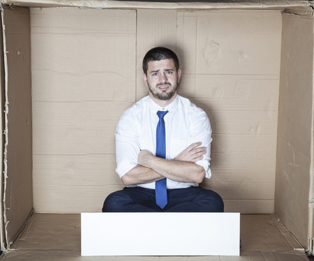 cramped space: unhappy employee Stock Photo