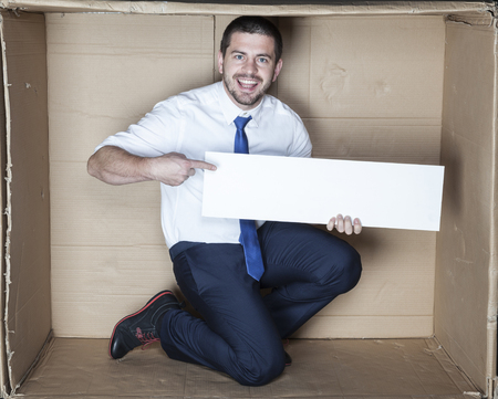 ad: Very happy businessman holding AD
