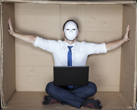 tight focus: businessman in a mask displaces office wall
