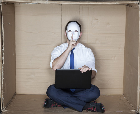 tight focus: hacker asks for silence Stock Photo