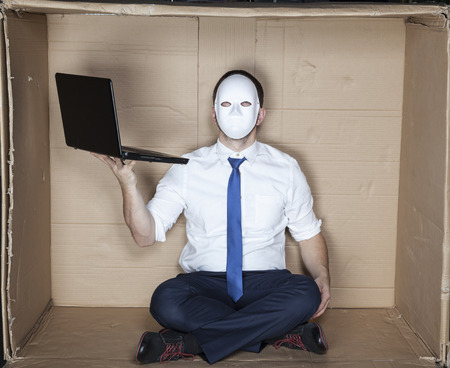 tight focus: hacker wearing mask and tie