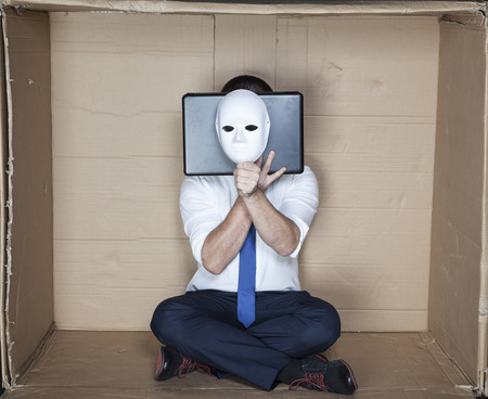 tight focus: hacker behind computer and mask