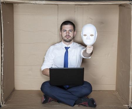 minimization: under the mask hides businessman Stock Photo