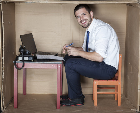 small office: happy businessman in the small office