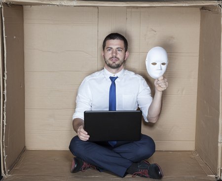 tight focus: hacker keep mask in his hand Stock Photo