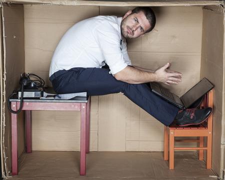 strange position to work, surprised businessman Reklamní fotografie