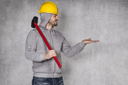 awkwardness: builder on a grey background, space for advertisement