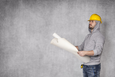 awkwardness: construction worker and copy space Stock Photo