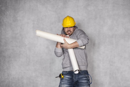helpless: helpless manual worker Stock Photo