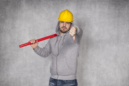 awkwardness: thumbs down from manual worker