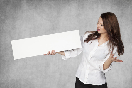 disbelief: business woman looking in disbelief at the advertisement