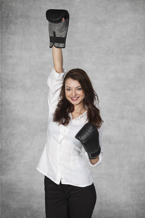 raises: business woman raises hand up, gesture of victory Stock Photo