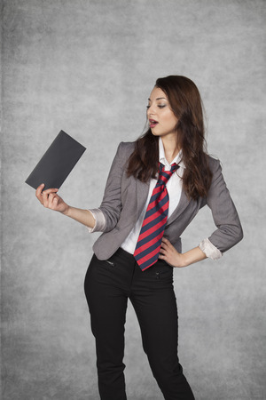 favoritism: Young businesswoman holding an envelope with a bribe Stock Photo