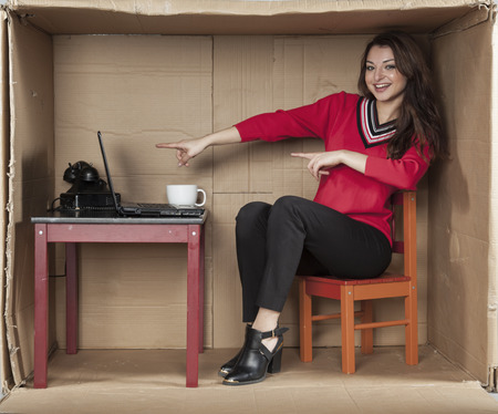 cramped space: business woman pointing to a computer