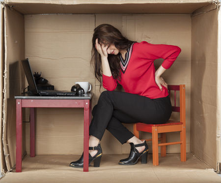 cramped space: secretary with back pain