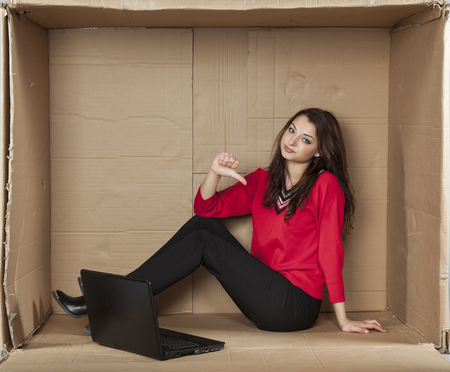 cramped space: businesswoman pointing at herself