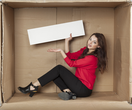 cramped space: business woman presenting copy space